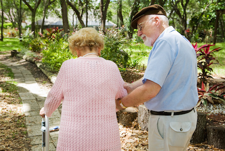 Stay active even with dementia. This man takes his wife on a walk.